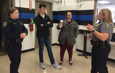 Msgt. Kristin Ceder (right) explains the OCPD Cadet Program at Metro Tech to Officer Brandi May, Andrew and Andrew's worker, Ashley Cain.