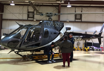 Pilot Tod Yates explains the features of the Airbus AS350 B3E helicopters used by OCPD to Andrew and his worker, Ashley Cain.