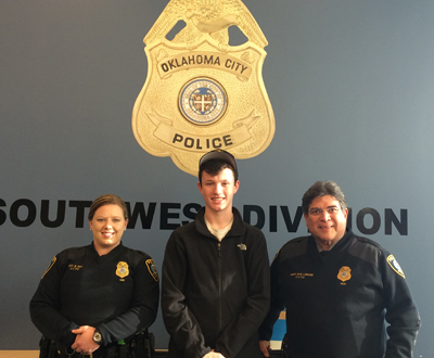 Pictured left to right at the OCPD Southwest Briefing Station are Officer Brandi May, Andrew and MSgt. Michael Loruse.